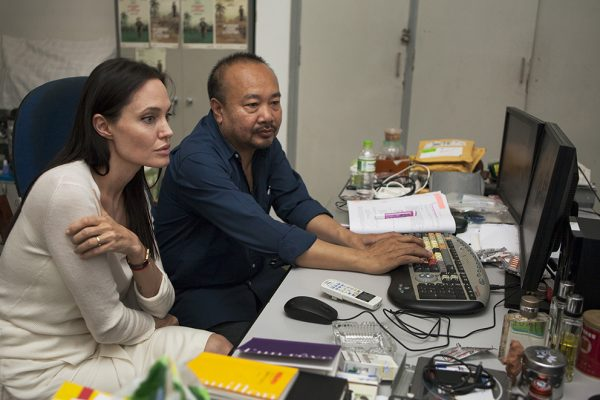PHNOM PENH, 28TH JULY 2015: Ms Angelina Jolie Pitt photographed with Mr Rithy Panh in his video suite during a vist to the Bophana Centre of Memory in Phnom Penh. The two will work together to make the film 'First They Killed My Father' about the war time experiences of Loung Un as a young child in Cambodia. Photo, Tom Stoddart/ Getty Reportage